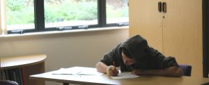 student taking an exam