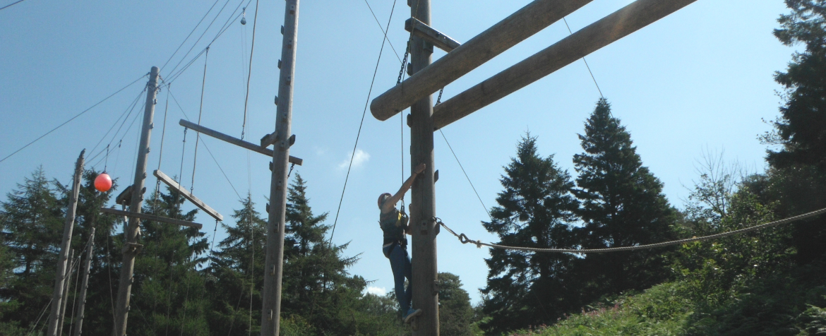 outdoor activities student on high ropes